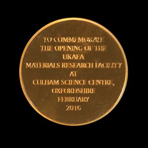 Back of UKAEA MRF Commemorative Coin in gold to mark the opening of the new Materials Research Facility in Oxfordshire in 2016